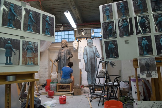 Rochester artist Olivia Kim working on the clay version of the new Frederick Douglass statue. PHOTO BY A. SUE WEISLER/RIT
